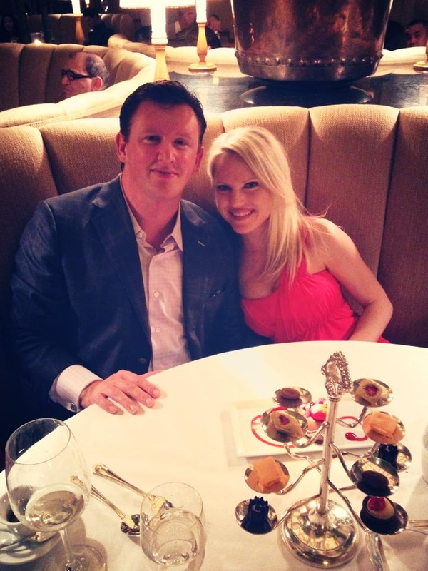 Caitlin and fiance at dinner after getting engaged