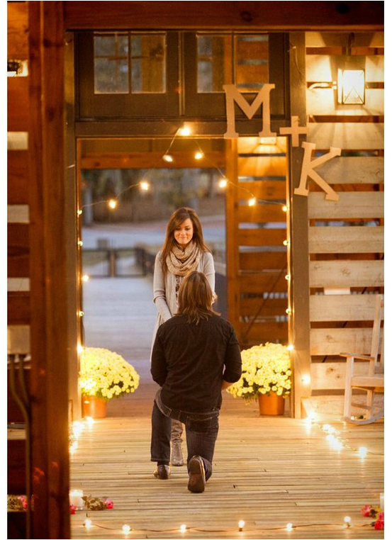 man proposing to girlfriend in cabin with light up lights