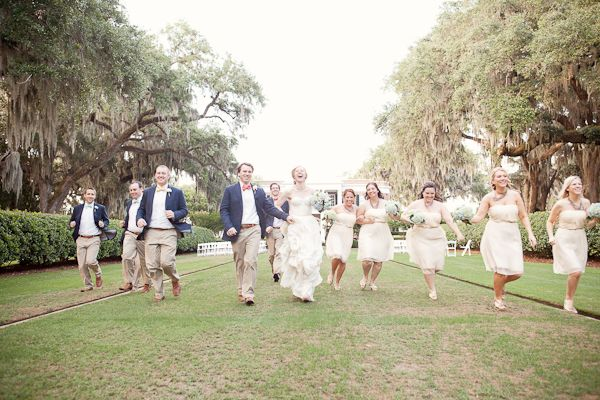 navy groomsmen jackets and khaki pants and white bridesmaid dresses