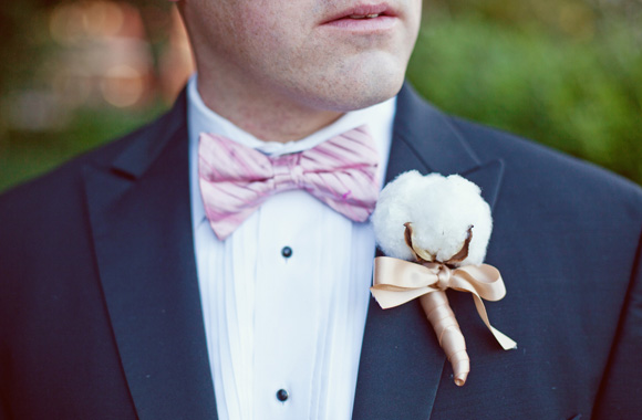 groom pink bow tie and gold and white boutonniere
