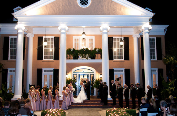 Wedding ceremony in front of large historic home