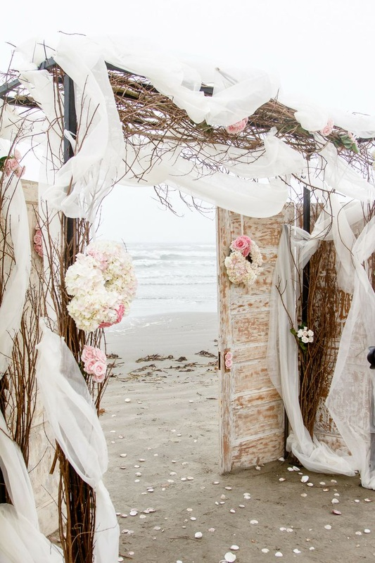 branch alter arbor on the beach for wedding