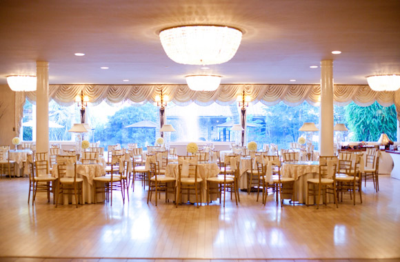 Southern reception hall with white wedding decor
