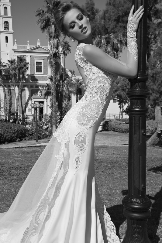 Tullia The Color Of This Dress Is A Tan Dusted Ivory With Sheer Shimmering Side Panels It Has Dramatic Oval Lace Details Going All Along Sides
