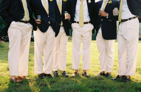 groomsmen in navy jackets and khaki pants