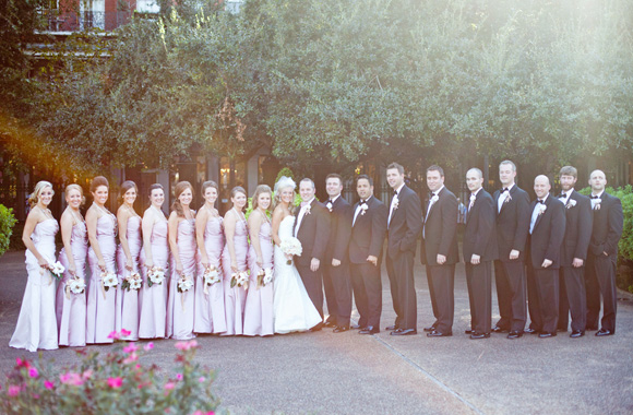 wedding picture: bridal party and bridesmaids in pink long dresses