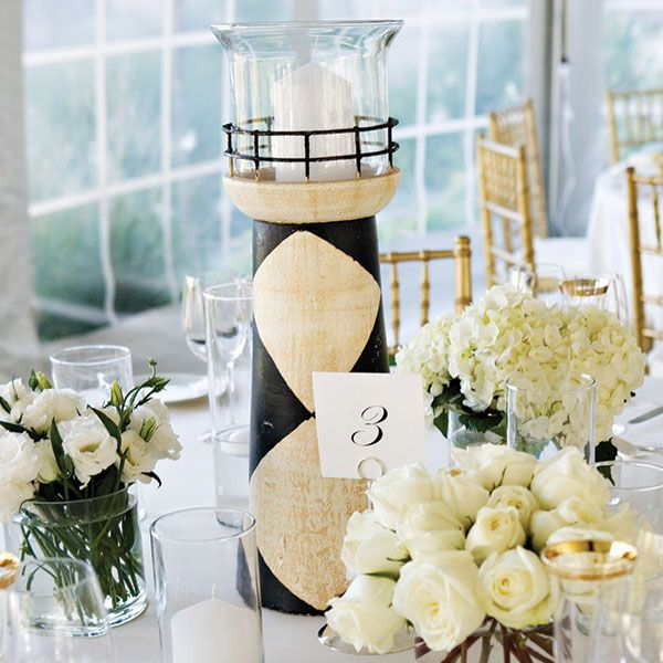 9 reasons to have a nautical wedding it girl weddings wedding table with lighthouse candle holder and white bouquets junglespirit Gallery