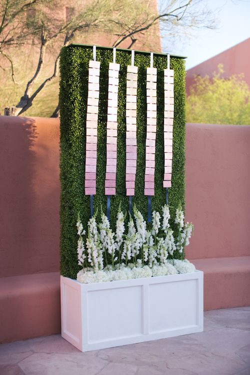 hedge with cascading escort cards