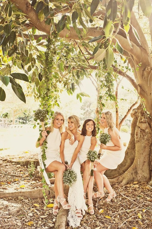 boho-chic bridesmaids on a swing