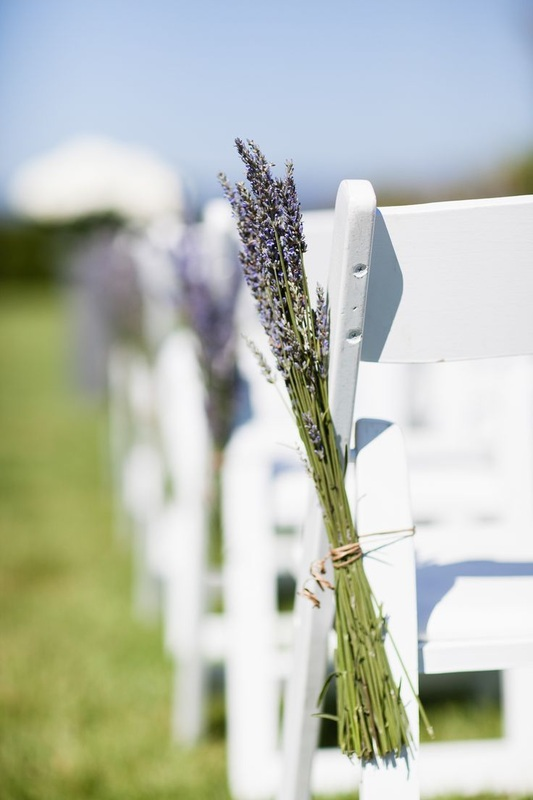 lavender on side of ceremony chairs