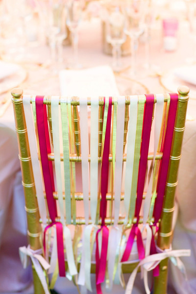 ribbons tied on back of reception chairs