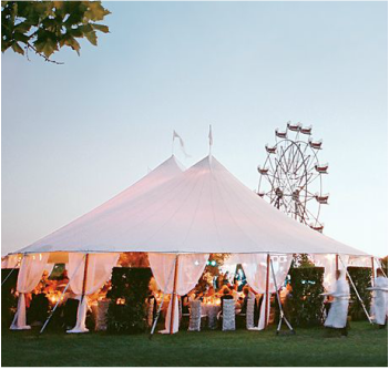 white wedding tent with hedges