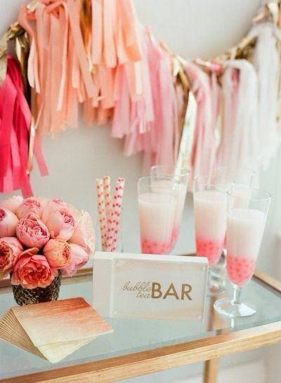 pink dessert table with tassle streamers