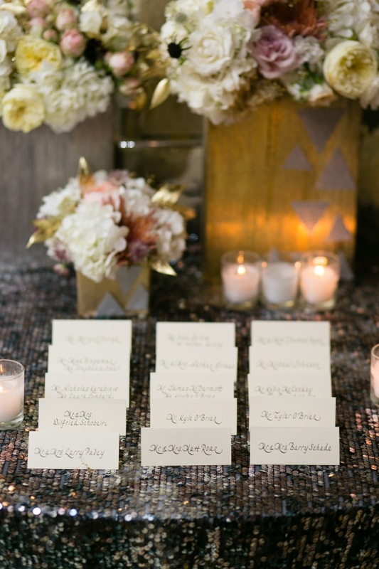 escort cards on silver linen and bouquets