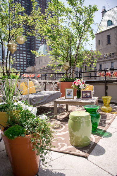 garden terrace overlooking city with chic seating and decor