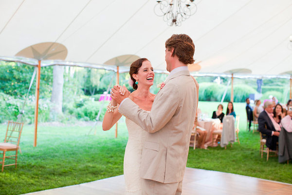 bride and groom dancing under marquee tent