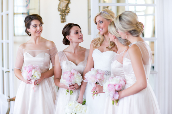 bride and bridesmaids talking before the wedding