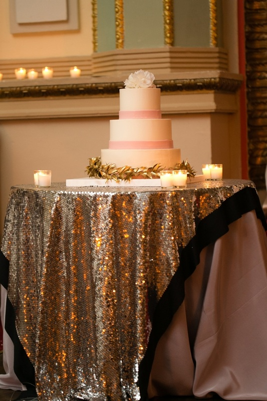 white and pink wedding cake on sparkle linen