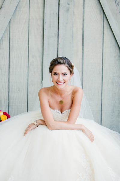 bride sitting in ballgown wedding dress