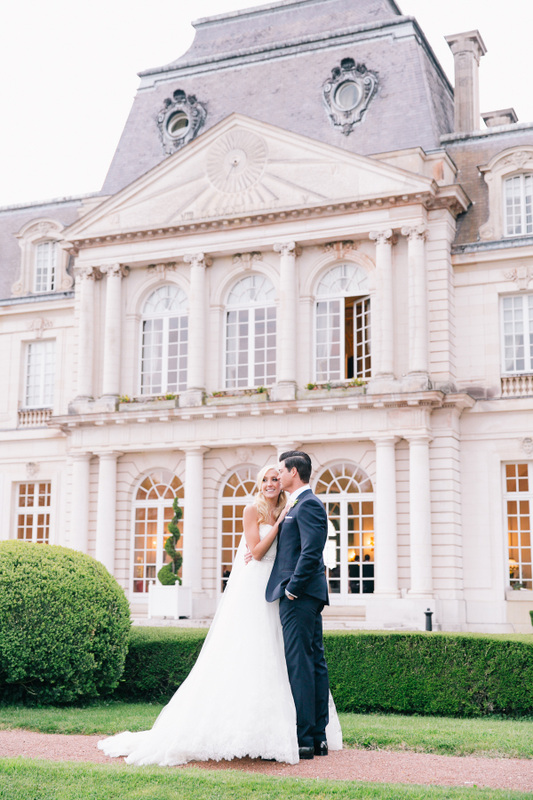 bride and groom with french chateau