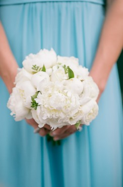 white bridesmaid bouquet and teal bridesmaid dresses