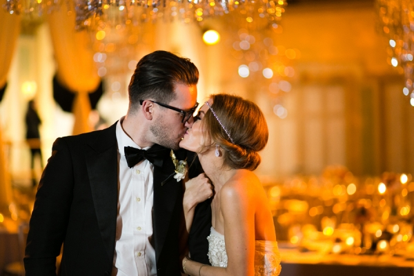 bride and groom kissing after wedding
