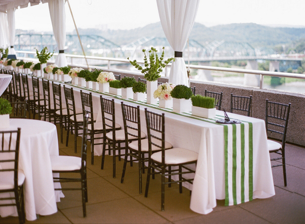 wedding tables with white and green striped linens