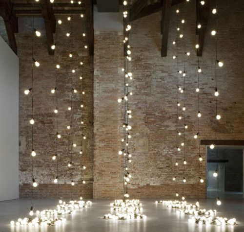 Christmas lights against wall at wedding ceremony