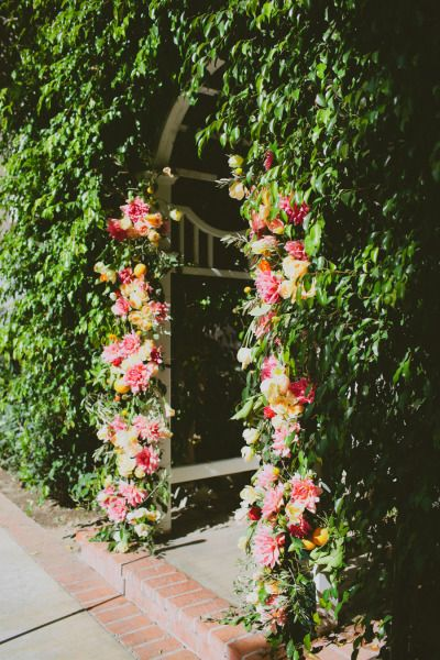 hedge archway with flowers