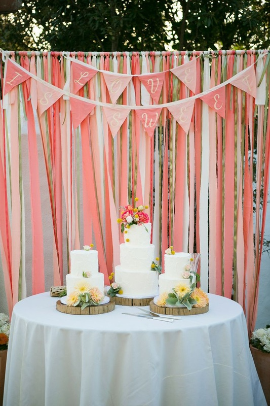 pink streamers at wedding with triangle sign
