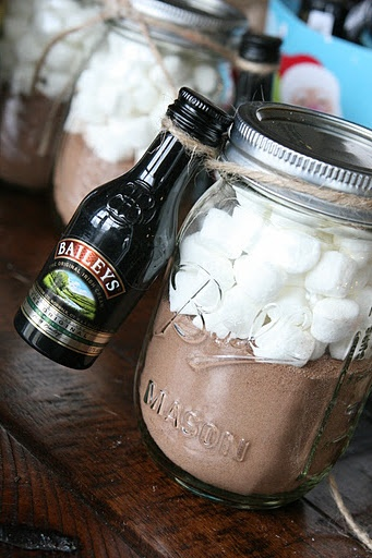 mason jars filled with hot chocolate and marshmallows with baileys