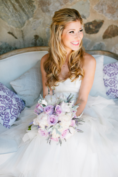 bride sitting with bouquet in ballgown wedding dress