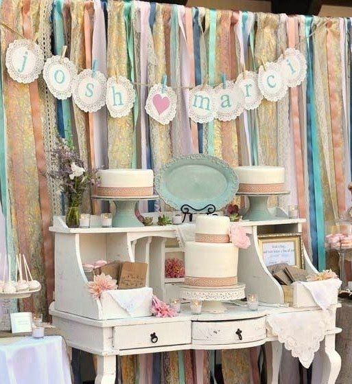 dessert table with streamers and monogrammed letters
