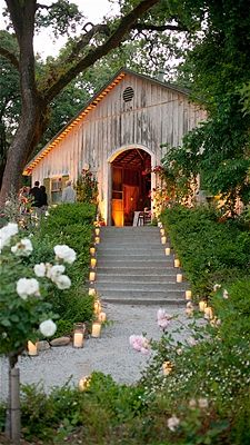 lighted pathway to barn wedding