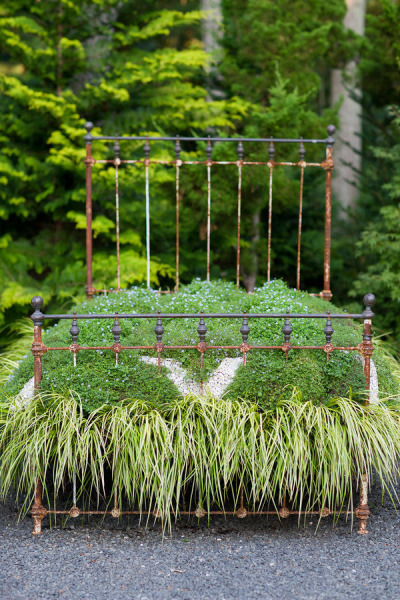 whimsical outdoor bed covered with grass
