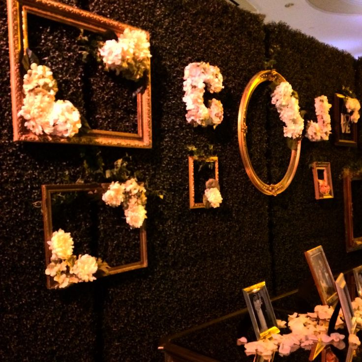 wedding hedges with gold frames and flowers