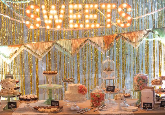 sweets table with streamer backdrop