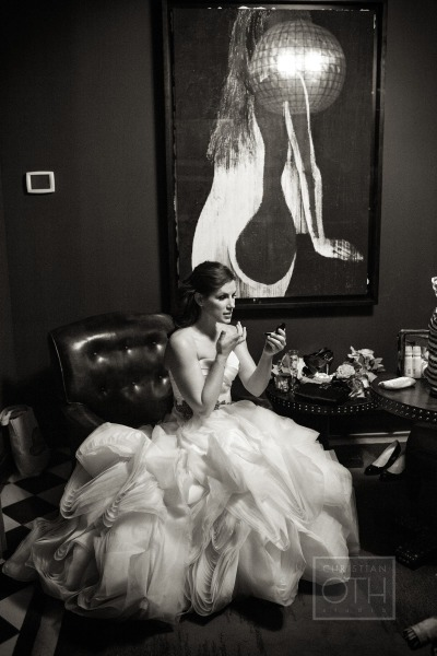 bride fixing her makeup in ballgown wedding dress