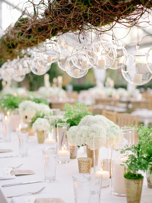 hanging votive candles at wedding reception