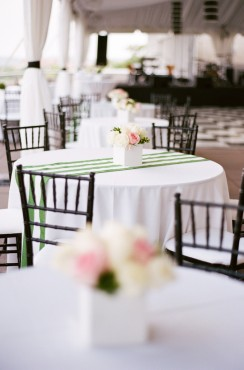 wedding cocktail tables with white and green striped linens