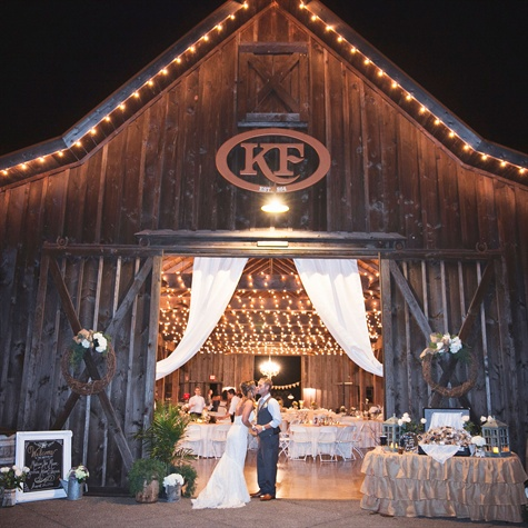 barn wedding with bistro lighting