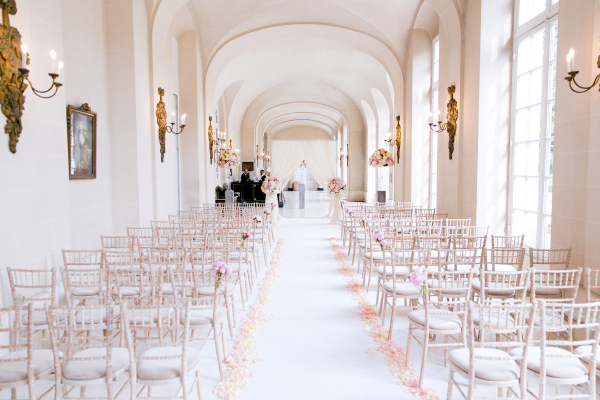 ceremony chairs and blush rose petals down the asile