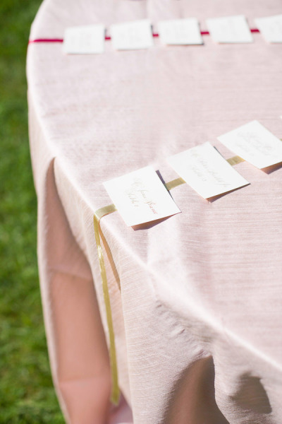 wedding escort cards attached to ribbon