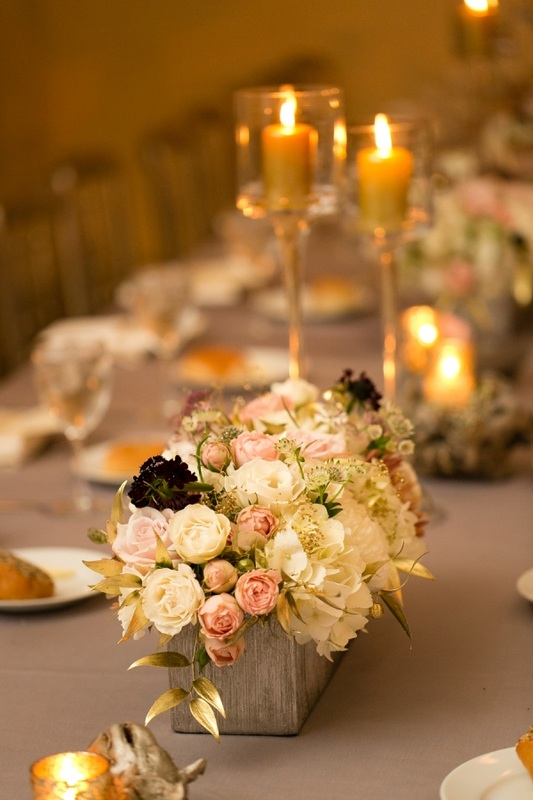grey linens and flower boxes at wedding reception