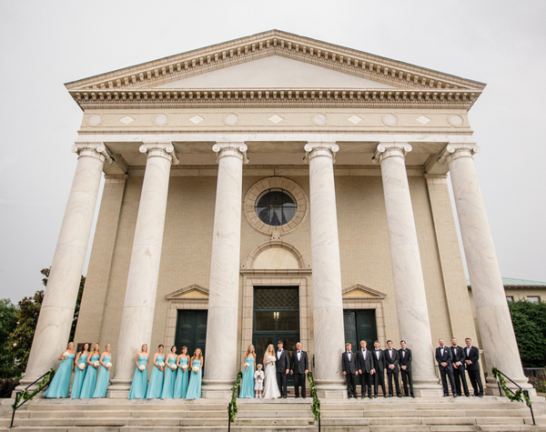 bridal party outside of large chapel