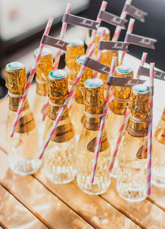 wedding favor: champagne wrapped with a straw