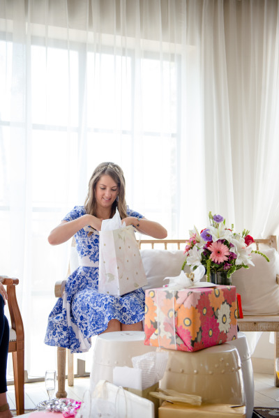 bride opening gifts at bridal shower