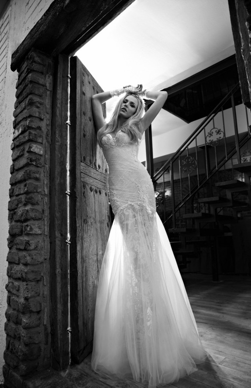 wedding dress sheer glittering net dress, draped with silk netting and sparkly pearl trims