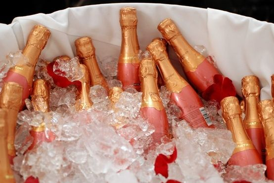 Small champagne bottles on ice