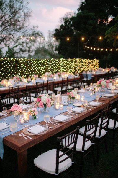 wedding hedges with Christmas lights and blue table runner